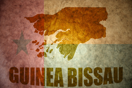 guinea bissau: guinea bissau map on a vintage guinea bissau flag background Stock Photo