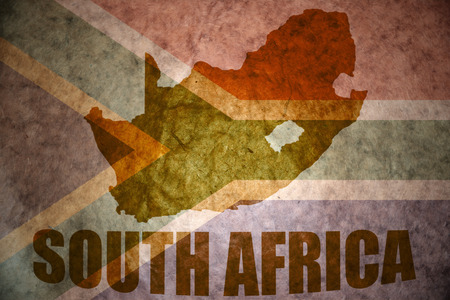 south africa map on a vintage south africa flag background 写真素材