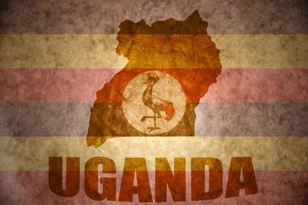 Carte ouganda sur un millésime fond de drapeau ougandais Banque d'images - 37508154
