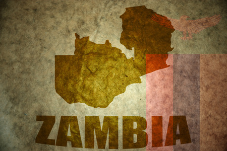 zambian flag: zambia map on a vintage zambian flag background Stock Photo