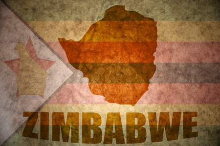 zimbabwe map on a vintage zimbabwean flag background Stock Photo