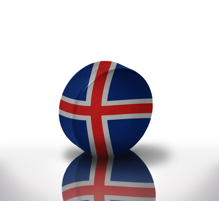 icelandic flag: vintage old hockey puck with the icelandic flag Stock Photo