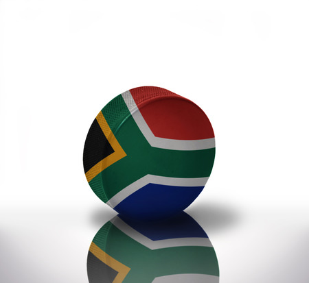 south africa flag: vintage old hockey puck with the south africa flag Stock Photo