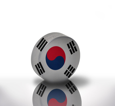 korean flag: vintage old hockey puck with the korean flag