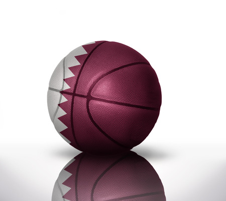 basketball ball with the national flag of qatar on a white background photo