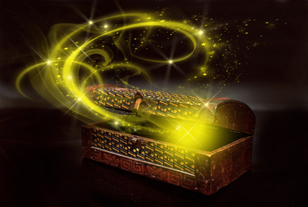 opened antique box with a yellow magic blown from inside Stock Photo - 38061539