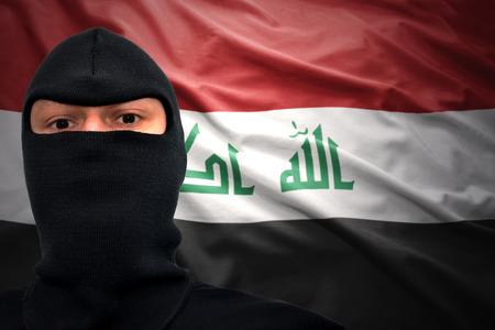 iraqi: dangerous man in a mask on a iraqi flag background