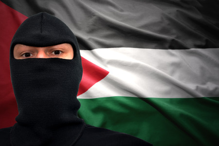 palestinian: dangerous man in a mask on a palestinian flag background