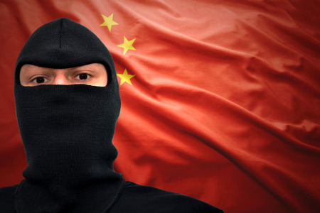 dangerous man: dangerous man in a mask on a chinese flag background