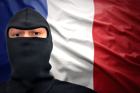 dangerous man in a mask on a french flag background