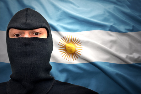 dangerous man: dangerous man in a mask on a argentinean flag background