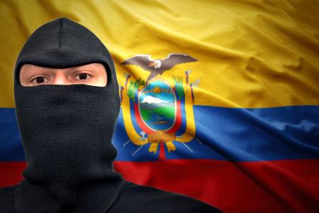 ecuadorian: dangerous man in a mask on a ecuadorian flag background