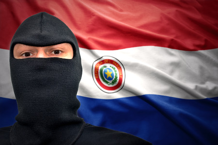 paraguayan: dangerous man in a mask on a paraguayan flag background