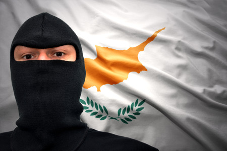 cypriot: dangerous man in a mask on a cypriot flag background
