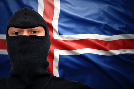 icelandic flag: dangerous man in a mask on a icelandic flag background