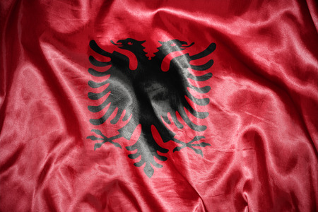 albanian: waving and shining albanian flag