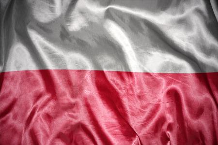 bandera de polonia: saludando y brillante bandera polaca Foto de archivo