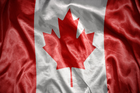canadian flag: waving and shining canadian flag Stock Photo