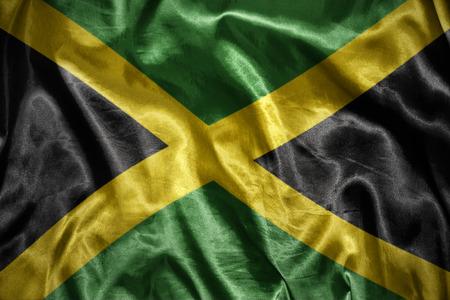 kingston: waving and shining jamaican flag