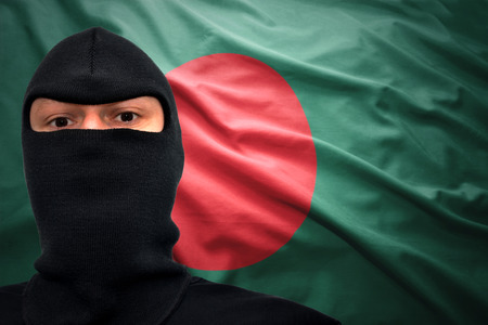 dangerous man: dangerous man in a mask on a bangladeshi flag background Stock Photo