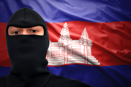 dangerous man: dangerous man in a mask on a cambodian flag background