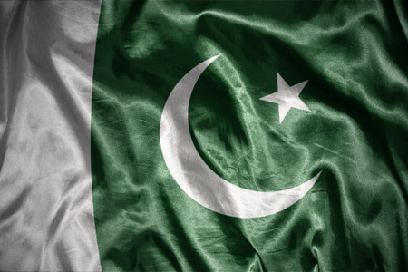 islamabad: waving and shining pakistani flag