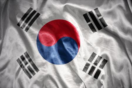 waving and shining south korea flag photo