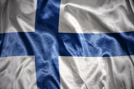 finnish: waving and shining  finnish flag Stock Photo