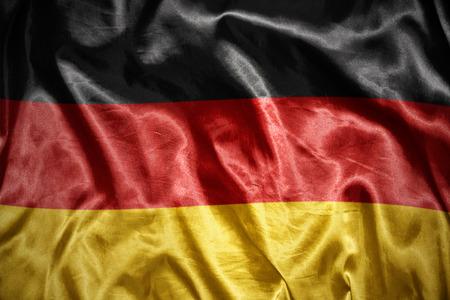 east berlin: waving and shining german flag