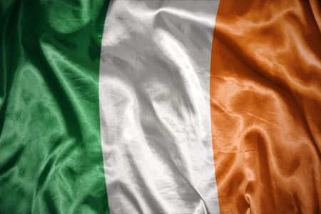 irish symbols: waving and shining irish flag