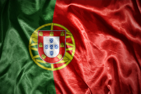 portuguese: waving and shining portuguese flag Stock Photo