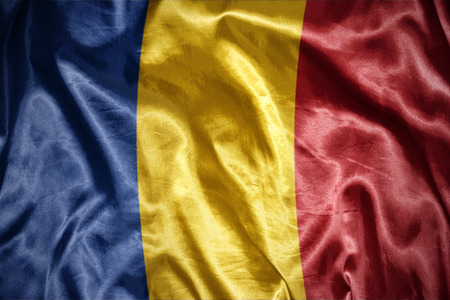 romanian: waving and shining romanian flag Stock Photo