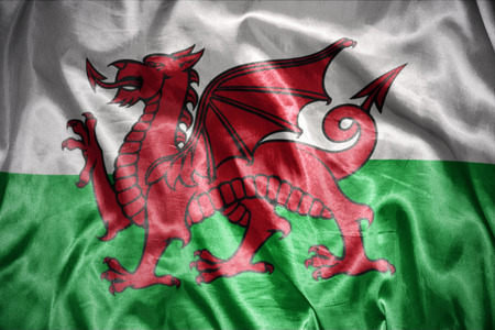 welsh flag: agitando e splendente gallese bandiera Archivio Fotografico