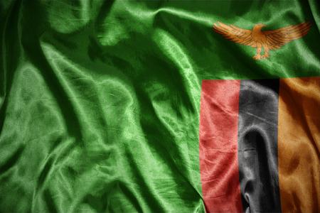 zambian flag: waving and shining zambian flag Stock Photo