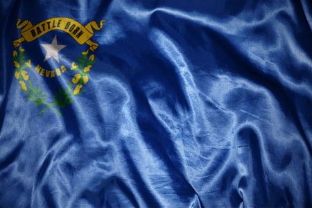 us sizes: waving and shining nevada state flag Stock Photo