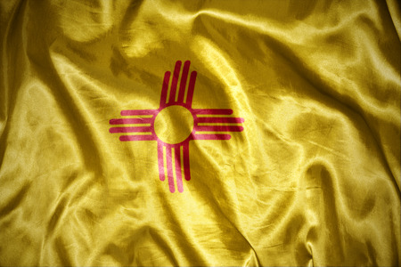 us sizes: waving and shining new mexico state flag Stock Photo