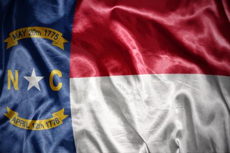 us sizes: waving and shining north carolina state flag Stock Photo