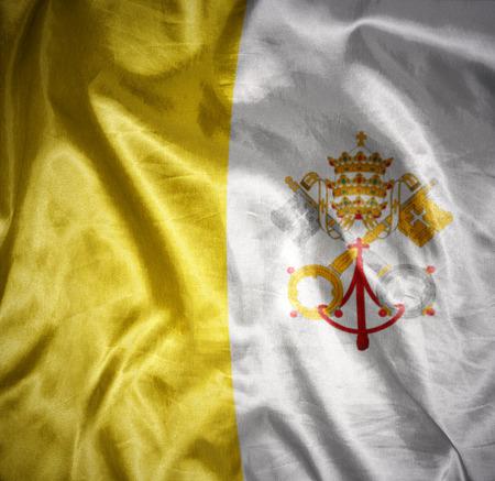 waving and shining vatican flag Stock Photo