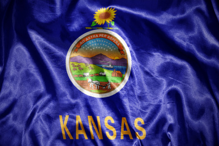 waving and shining kansas state flag