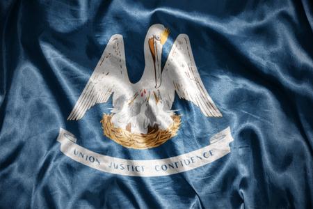 us sizes: waving and shining louisiana state flag Stock Photo