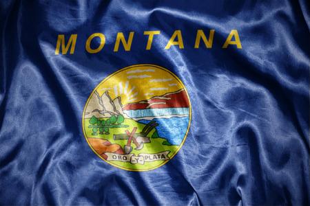 us sizes: waving and shining montana state flag Stock Photo