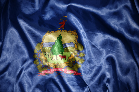 us sizes: waving and shining vermont state flag Stock Photo
