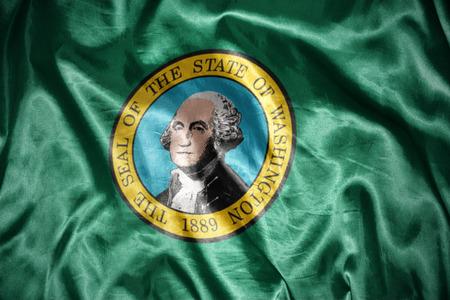 us sizes: waving and shining washington state flag Stock Photo