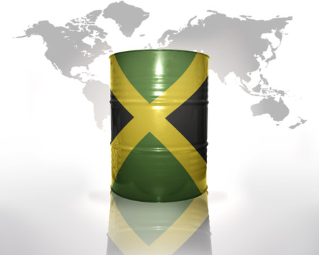jamaican flag: barrel with jamaican flag on the world map background Stock Photo