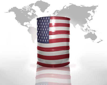 barrel with american flag on the world map background photo