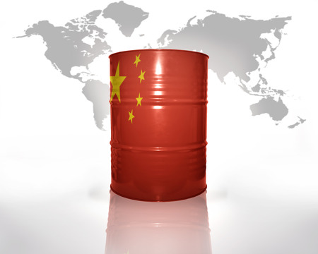 barrel with chinese flag on the world map background photo