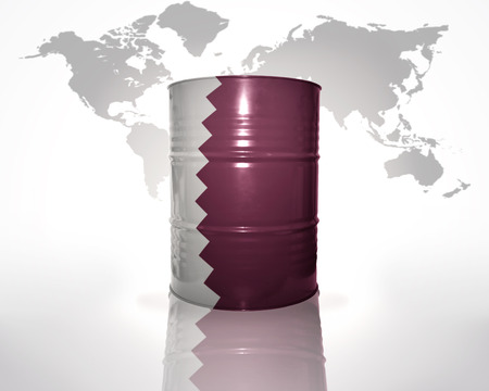 barrel with qatar flag on the world map background photo
