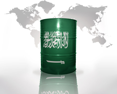 barrel with saudi arabia flag on the world map background photo