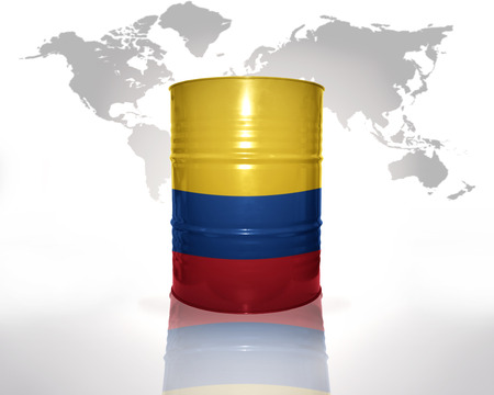 colombian flag: barrel with colombian flag on the world map background