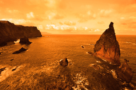 marvellous: Beautiful deserted planet with vast ocean in orange colors Stock Photo